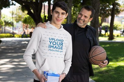 Hoodie Mockup of a Young Man and His Dad on Fathers' Day 33094
