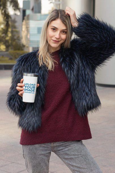 Mockup of a Stylish Woman Holding a Travel Mug 31826