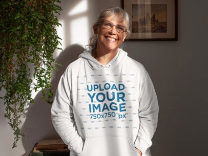 Mockup of a Happy Woman Wearing a Hoodie In Her Home 32213