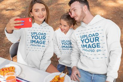 Hoodie Mockup of a Family Taking a Selfie on 4th of July 33036