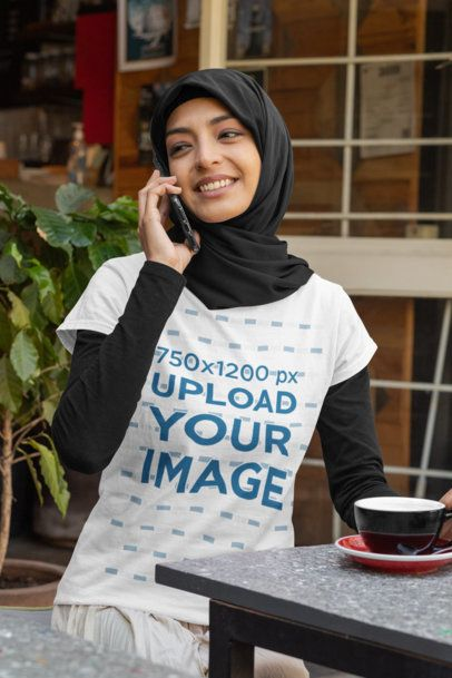 Mockup Featuring a Woman with a T-Shirt Talking on the Phone at a Restaurant 32387