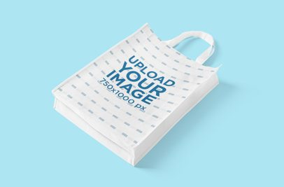 Mockup of a Grocery Bag Lying on a Plain Color Surface 3126-el1