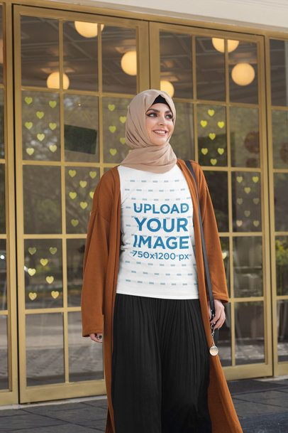 Mockup of a Woman with a Tee and a Hijab Walking on the Street 32416
