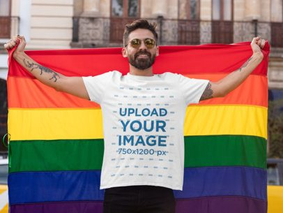 T-Shirt Mockup Featuring a Proud Man Holding the LGBT Flag 32989