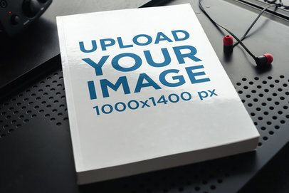 Mockup of a Paperback Book on a Dark-Color Metal Surface 3416-el1