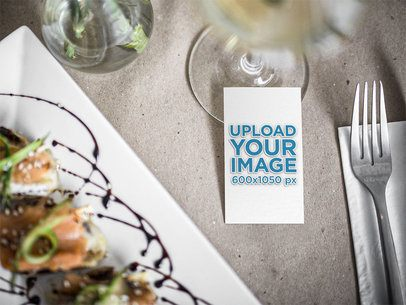 Mockup of a Vertical Business Card on a Dinner Table 33769