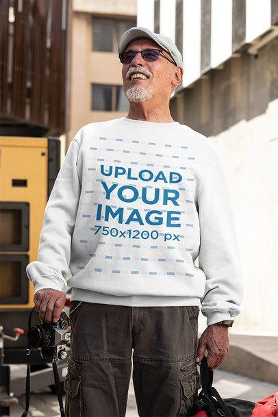 T-Shirt Mockup of a Senior Man with Sunglasses Holding a Camera 32882