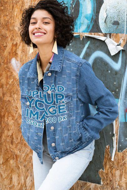 Denim Jacket Mockup of a Woman Posing Against a Wall 32573