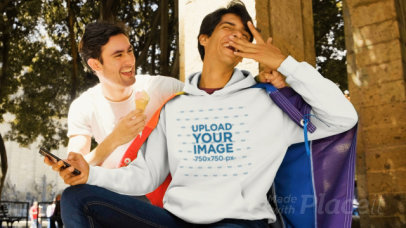 Hoodie Mockup Featuring a Couple Playing with an Ice-Cream 33354