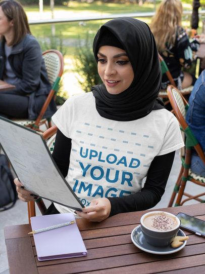 T-Shirt Mockup Featuring a Woman Wearing a Hijab and Ordering at a Restaurant 32413