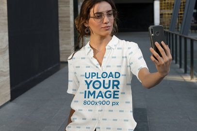 Sublimated Button-Up Shirt Mockup of a Woman Taking a Selfie 33128