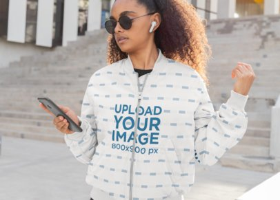 Bomber Jacket Mockup Featuring a Woman Listening to Music 33219