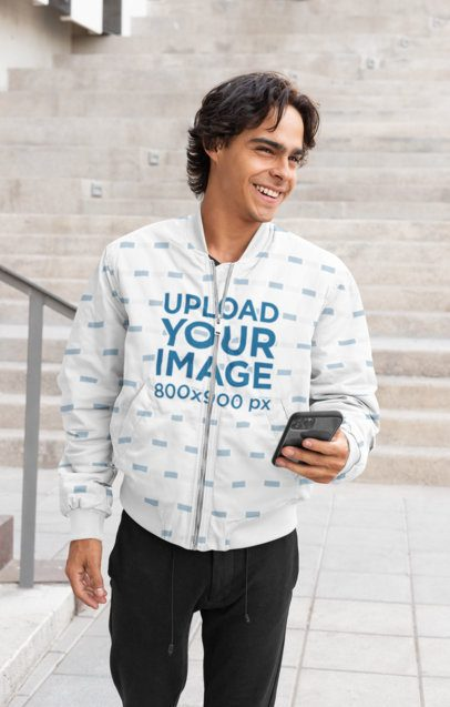 Bomber Jacket Mockup Featuring a Man with a Phone 33221