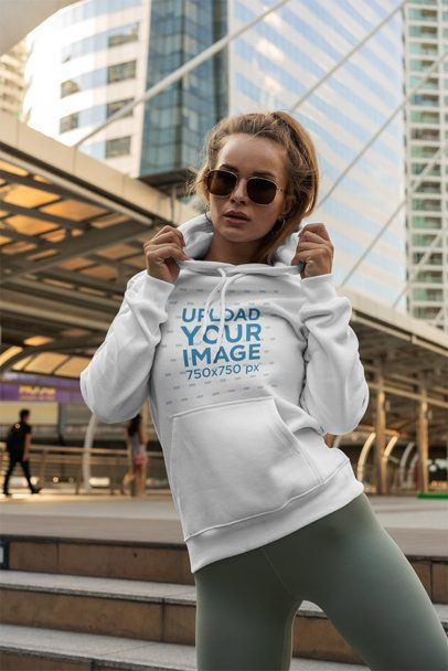 Mockup of a Trendy Woman Posing with a Hoodie Next to a Bridge 3557-el1