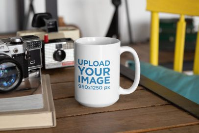 Mockup of a 15 oz Coffee Mug Placed Next to Some Vintage Cameras 33192