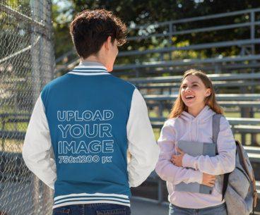 Varsity Jacket Mockup Featuring a Man Talking to a Friend 33209
