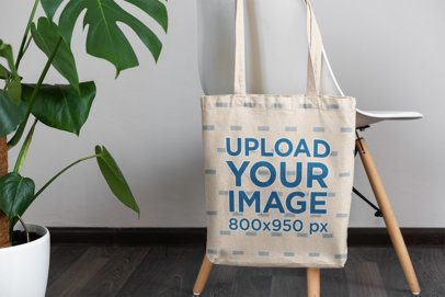 Mockup Featuring a Tote Bag Hanging From a Modern Chair 3148-el1
