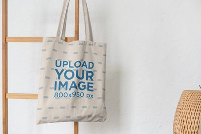 Mockup of a Tote Bag Hanging from a Wooden Stair 3141-el1