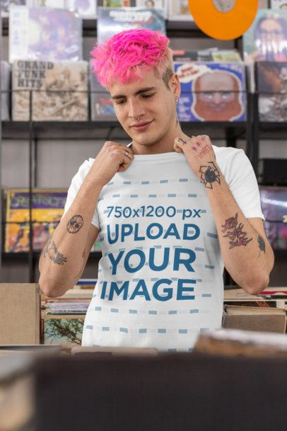 T-Shirt Mockup Featuring a Man With Pink Hair at a Music Store 33311