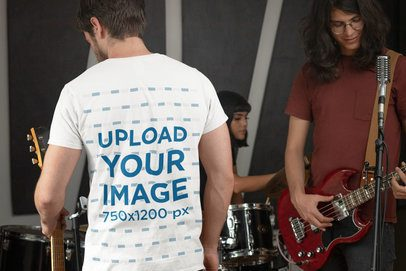 Back-View T-Shirt Mockup Featuring a Man in a Rock Band 33336