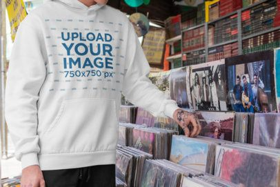 Pullover Hoodie Mockup Featuring a Man at a Records Shop 33317
