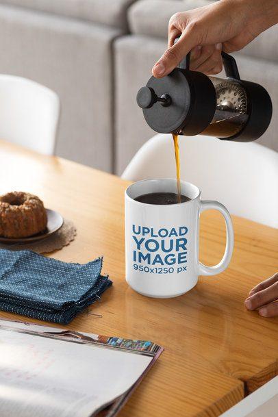 Mockup of a Person Pouring Coffee Into a 15 oz Mug 33180