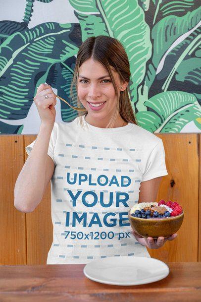 T-Shirt Mockup of a Woman Eating a Healthy Fruit Bowl 32760