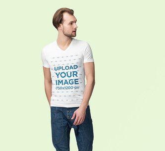 V-Neck T-Shirt Mockup of a Man Posing Against a Plain Color Backdrop 3691-el1