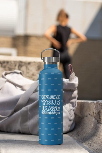 Aluminum Bottle Mockup Featuring a Woman in the Background 33498