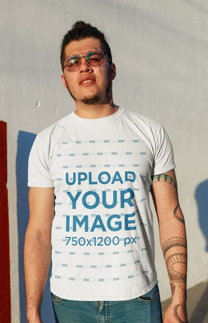 T-Shirt Mockup Featuring a Tattooed Man at Sunset 32813