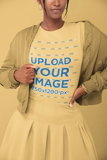 T-Shirt Mockup of a Woman in a Monochromatic Outfit Posing at a Studio 32795