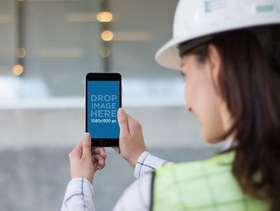 Mockup of a Female Architect Taking a Picture with an iPhone 6 Plus 12580b