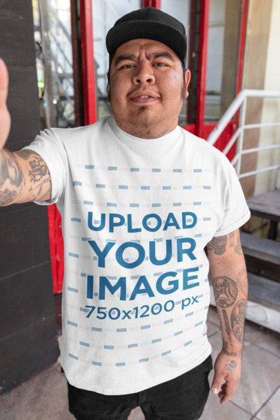 T-Shirt Mockup of a Man with Tattooed Arms Taking a Selfie 32857