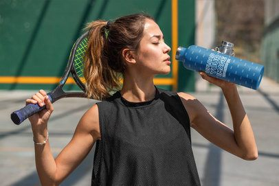 Aluminum Bottle Mockup Featuring a Woman at a Tennis Court 33494