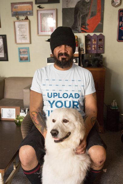 T-Shirt Mockup Featuring a Man at Home with His Dog 32837