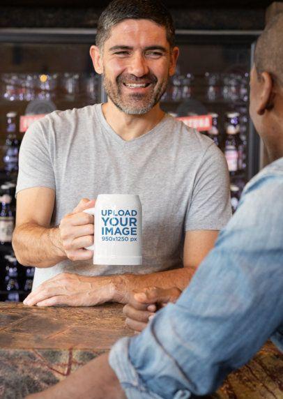 Mockup of a Man Holding a Beer Mug at a Bar 33422