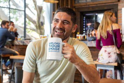 Mockup of a Happy Man Holding a Beer Mug 33431