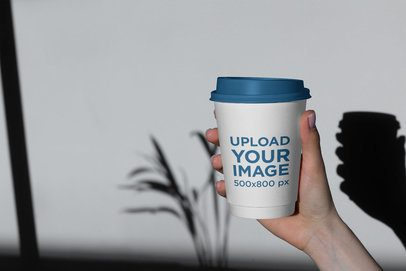 Mockup of a Woman Holding a Coffee Cup with Customizable Lid 3763-el1