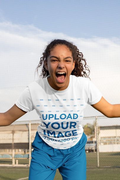 Jersey Mockup of a Teenage Girl Celebrating at a Soccer Field 33566