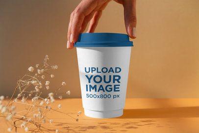 MInimalist Mockup of a Woman Holding a Coffee Cup 3770-el1