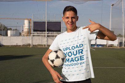 Mockup Featuring a Teenager With a Soccer Ball Pointing at His T-Shirt 33584