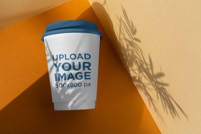 Elegant Mockup of a Coffee Cup Under a Shadow 3772-el1