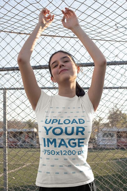 T-Shirt Mockup Featuring a Teen Posing by a Soccer Net 33564