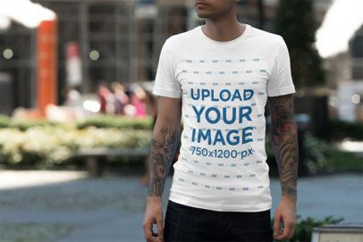 Tee Mockup Featuring a Man with Tattooed Arms on the Street 3362-el1