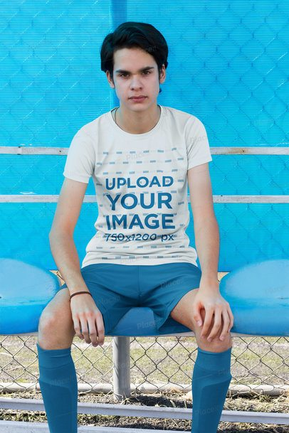 Jersey Mockup of a Teen Soccer Player on the Bench 33553