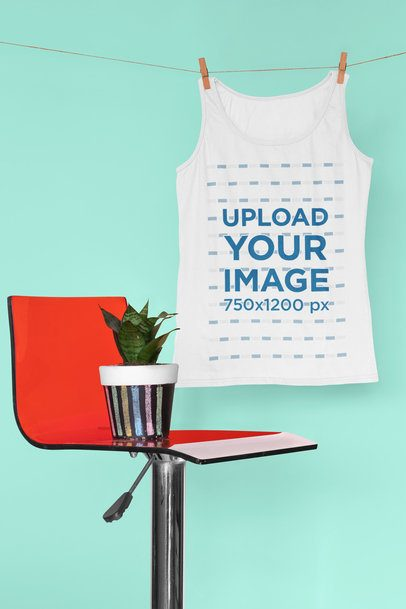 Mockup of a Tank Top Hanging By a Red Chair 33956