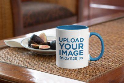 Mockup of an 11 oz Coffee Mug Next to a Fruit Plate 33812