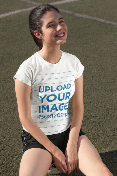 T-Shirt Mockup Featuring a Teenage Girl in a Soccer Field 33576