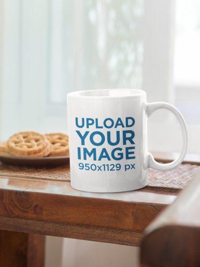 Mockup of an 11 oz Coffee Mug by a Plate of Cookies 33815