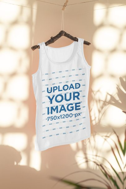 Mockup of a Tank Top Hanging on a Bedroom Featuring Some Shadows 33960
